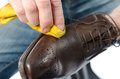 Shoe shining shiner a brown with a yellow rag Stock Photos