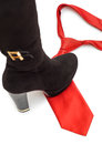 Shoe steps on a necktie red symbolising woman dominating over man Royalty Free Stock Photography
