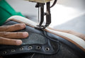 Shoe stitching a is one of process in footwear industry Royalty Free Stock Images