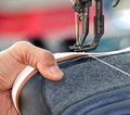 Shoe stitching process in footwear industry Stock Photos