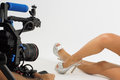 Shoe video shoot a camera filming of woman s feet and shoes in a studio Stock Photography