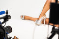 Shoe video shoot a in a studio with a camera lights and female feet and shoes Royalty Free Stock Image