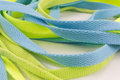 Shoelace sports isolated clothing accessories light green color blue white Royalty Free Stock Image