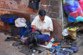 Shoemaker in india indian at work the street vasco da gama town indian state of goa Royalty Free Stock Image