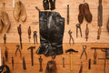 Shoemaker tools hanging in a wooden wall Stock Photos