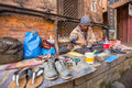 Shoemaker works on the street the caste system is still intact today but the rules are not as rigid as they were in the past Royalty Free Stock Photo