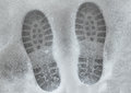 Shoeprints in melting snow Royalty Free Stock Images