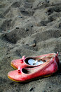 Shoes on the beach Royalty Free Stock Photo