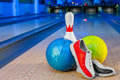 Shoes, bowling pin and ball for bowling game Royalty Free Stock Photo