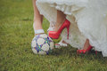 Shoes of bride and her bridesmaids on a ball wedding soccer Royalty Free Stock Photo