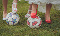 Shoes of bride and her bridesmaids on a ball wedding soccer Royalty Free Stock Images