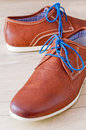 Shoes detail of men s leather with colorful laces Stock Photo