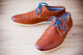 Shoes detail of men s leather with colorful laces Royalty Free Stock Images