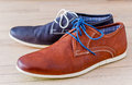 Shoes detail of men s leather with colorful laces each in different colour Royalty Free Stock Photo