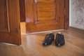 Shoes at doors 1404. Royalty Free Stock Photo