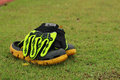 Shoes and gloves football in green grass. Royalty Free Stock Photo