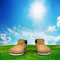 Shoes on green field. Adventure Stock Photography