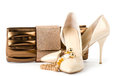 Shoes with handbag and golden jewelry Royalty Free Stock Photography
