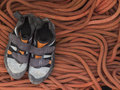Shoes for mountaineering and rock climbing is on the rope orange Stock Photography