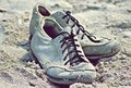 Shoes on sand beach Royalty Free Stock Photo