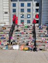 Shoes and teddy bears left on kingston city hall steps in memory of 215 children's graves found in kamloops Royalty Free Stock Photo