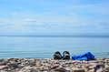 Shoes and towel at coast the of baltic sea on the island oland in sweden Royalty Free Stock Images