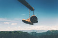 Shoes trekking boots hanging over mountains Royalty Free Stock Photo