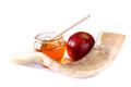 Shofar (horn), honey, apple isolated on white. rosh hashanah (jewish holiday) concept . traditional holiday symbol. Royalty Free Stock Photo
