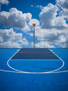 Shoot for the sky a basketball court net and backboard against a blue and clouds reach clouds Stock Images