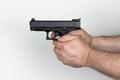Shooter holds black handgun caliber mm Royalty Free Stock Image
