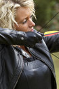 Shooting with bow and arrow Stock Photos
