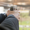 Shooting with a pistol. Man aiming pistol in shooting range. Royalty Free Stock Photo