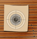 Shooting range target with bullet holes illustration Royalty Free Stock Image