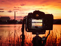 Shooting the sunrise in washington dc a digital single lens reflex camera set upon a tripod capturing images of monuments at Stock Photography