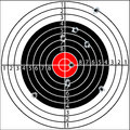 Shooting target with holes pierced by bullets Royalty Free Stock Photography