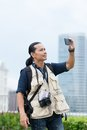 Shooting video press photographer or taking photo with a smartphone Stock Photo
