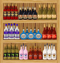Shop alcoholic beverages store shelf with bottles of alcohol Royalty Free Stock Images