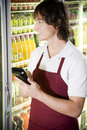 Shop assistant stocktaking in a supermarket Royalty Free Stock Photo