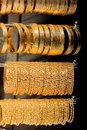 Shop display of dozens of golden bracelets Royalty Free Stock Photo