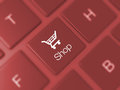 Shop key on keyboard and shopping cart icon red blurry Royalty Free Stock Images