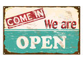 Shop open enamel sign come in we are rusty old Stock Image