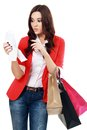 Shopaholic attractive brunette woman looking at her receipt overspending Royalty Free Stock Photo