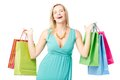 Shopaholic portrait of happy female with colorful paperbags looking at camera Royalty Free Stock Images