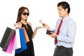 Shopaholic wife palm out money reluctant husband a superficial stylish asian female holding department store bags holds hand to Stock Images