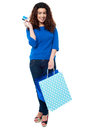 Shopaholic woman holding shopping bags and credit card Royalty Free Stock Photo