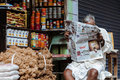 Shopkeeper mysore india july th a shop keeper reading the morning newspaper in mysore south india on th july Stock Photo