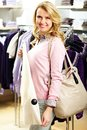 Shopper with cardigan portrait of pretty woman fashionable in clothing department Stock Photography