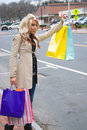 Shopper Hailing a Cab Royalty Free Stock Images