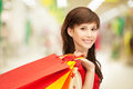 Shopper happy teenage girl with shopping bags at the mall Royalty Free Stock Photography