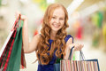 Shopper happy woman with shopping bags at the mall Stock Photo